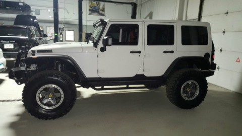2012 Jeep Wrangler Unlimited Altitude Sport Utility 4-Door 3.6L for sale