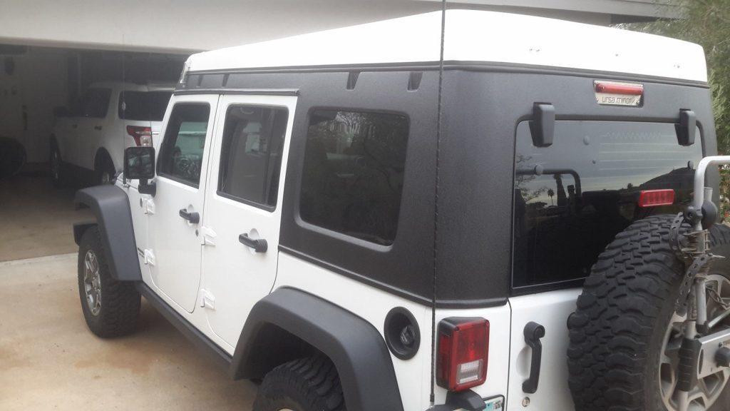 2014 Jeep Wrangler with Ursa Minor Pop Top camper