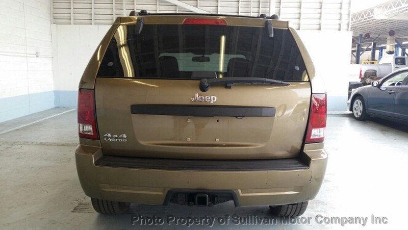 2009 Jeep Grand Cherokee Laredo 4.7L V8 GOLD
